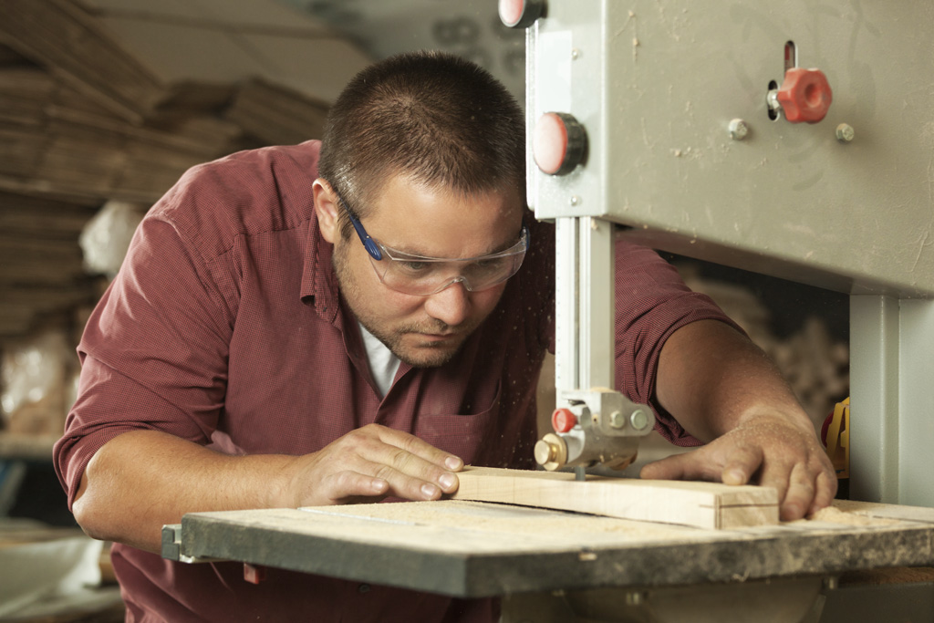 man on bandsaw